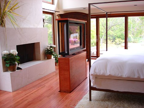 Tv lift built into wood floor international design awards for Bed built into floor