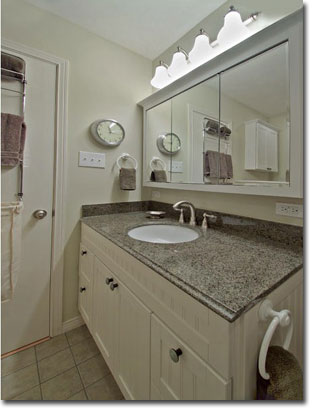 The Granite Vanity And Oversized Medicine Cabinet With Ensemble Matching  Cabinet Above The Toilet, Address The Common ...